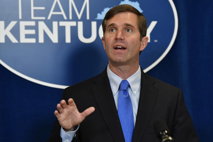 Kentucky Gov. Andy Beshear speaks to reporters following the signing of bills related to the American Rescue Plan Act at the Kentucky State Capitol in Frankfort, Ky., Wednesday, April 7, 2021. (AP Photo/Timothy D. Easley)
