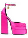 """<p><strong>Versace</strong></p><p>saksfifthavenue.com</p><p><strong>$1295.00</strong></p><p><a href=""""https://go.redirectingat.com?id=74968X1596630&url=https%3A%2F%2Fwww.saksfifthavenue.com%2Fproduct%2Fversace-satin-platform-pumps-0400014550162.html&sref=https%3A%2F%2Fwww.harpersbazaar.com%2Ffashion%2Ftrends%2Fg35556071%2Ffall-2021-shoe-trends%2F"""" rel=""""nofollow noopener"""" target=""""_blank"""" data-ylk=""""slk:Shop Now"""" class=""""link rapid-noclick-resp"""">Shop Now</a></p><p>See over the crowd in a double-layered platform pump. Kitten heels can be fun, but embrace your inner drama queen by adding this platformed pop of pink to your closet.</p>"""