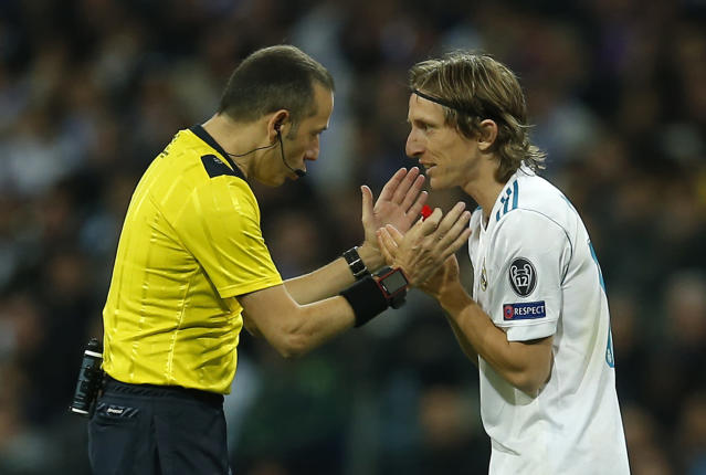 Referee Cuneyt Cakir speaks with Real Madrid's Luka Modric during the Champions League semifinal second leg soccer match between Real Madrid and FC Bayern Munich at the Santiago Bernabeu stadium in Madrid, Spain, Tuesday, May 1, 2018. (AP Photo/Paul White)