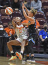 Connecticut Sun guard Jasmine Thomas commits a turnover under pressure from Chicago Sky guard Courtney Vandersloot during a WNBA semifinal playoff basketball game, Tuesday, Sept. 28, 2021, at Mohegan Sun Arena in Uncasville, Conn. (Sean D. Elliot/The Day via AP)