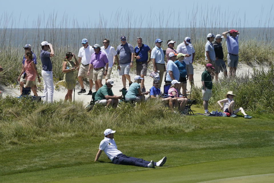 Bernd Wiesberger, of Austria, sits on the ground as he waits for another golfer to find a ball on the 16th hole during the first round of the PGA Championship golf tournament on the Ocean Course Thursday, May 20, 2021, in Kiawah Island, S.C. (AP Photo/Matt York)
