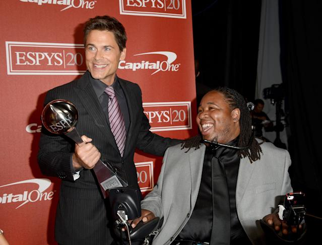LOS ANGELES, CA - JULY 11: (L-R) Actor Rob Lowe and recipient Eric LeGrand with the Jimmy V Award for perseverance pose backstage during the 2012 ESPY Awards at Nokia Theatre L.A. Live on July 11, 2012 in Los Angeles, California. (Photo by Jason Merritt/Getty Images)
