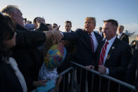 "FILE - In this Feb. 18, 2020, file photo President Donald Trump greets supporters after arriving at Los Angeles International Airport in Los Angeles. Public health officials were already warning Americans about the need to prepare for the coronavirus threat in early February when President Donald Trump called it ""deadly stuff"" in a private conversation that has only now has come to light. (AP Photo/Evan Vucci, File)"