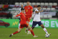 United States' Tyler Adams vies for the ball with Wales' Harry Wilson during the international friendly soccer match between Wales and USA at Liberty stadium in Swansea, Wales Thursday, Nov. 12, 2020. (AP Photo/Kirsty Wigglesworth)
