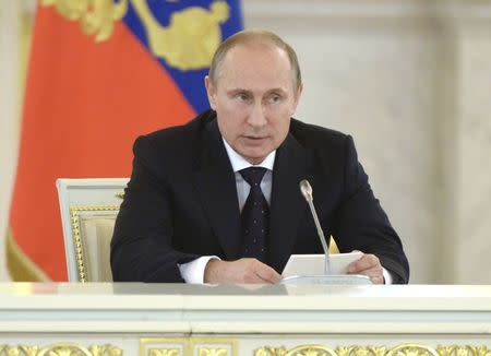 Russian President Putin speaks during a meeting of the Presidential Council on Inter-Ethnic Relations in the Kremlin
