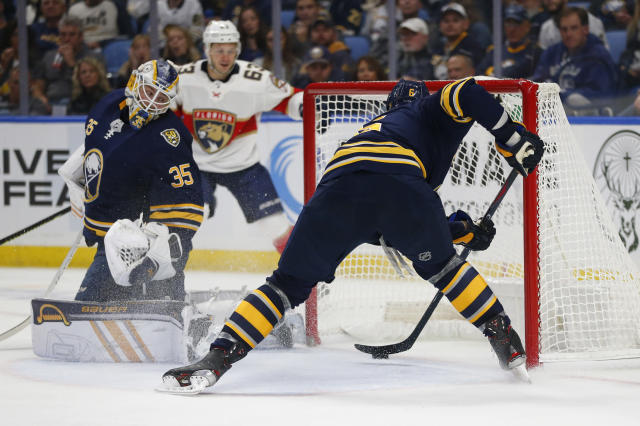 Buffalo Sabres defenseman Marco Scandella (6) stops the puck from crossing the goal line during the second period of an NHL hockey game against the Florida Panthers, Friday, Oct. 11, 2019, in Buffalo, N.Y. (AP Photo/Jeffrey T. Barnes)
