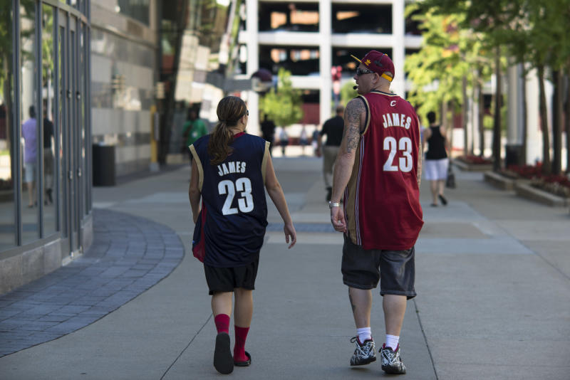 Fans wearing Lebron James jerseys walk past The Quicken Loans Arena on July 11, 2014 in Cleveland, Ohio