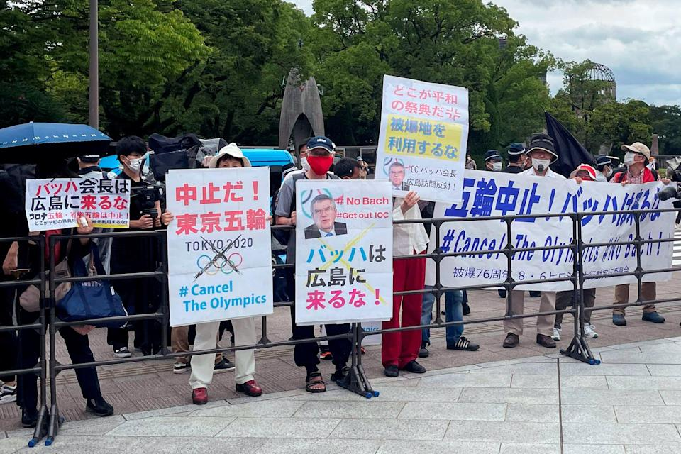 Protesters gather before International Olympic Committee President Thomas Bach's visit Hiroshima Memorial Cenotaph in Hiroshima (REUTERS)