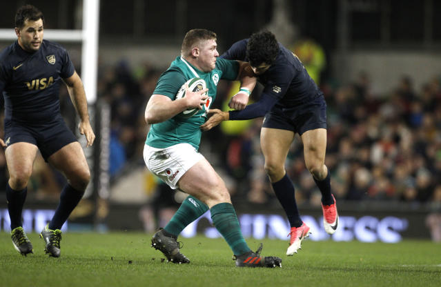 Ireland's Tadhg Furlong, centre, is tackled by Matias Moroni of Argentina during a rugby union international match at the Aviva stadium in Dublin, Ireland, Saturday, Nov. 25, 2017. (AP Photo/Peter Morrison)