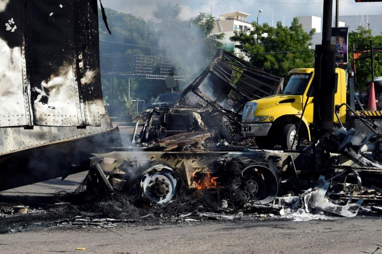 Burned vehicles simmer after the violence in Culiacan (AFP Photo/ALFREDO ESTRELLA)