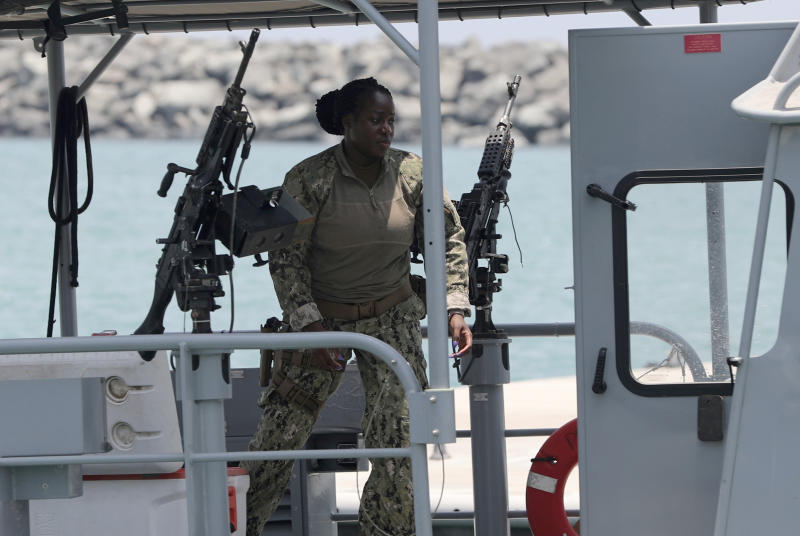 "A U.S. Navy personnel prepares at a patrol boat to carry journalists to see damaged oil tankers leaves a U.S. Navy 5th Fleet base, during a trip organized by the Navy for journalists, near Fujairah, United Arab Emirates, Wednesday, June 19, 2019. Cmdr. Sean Kido of the U.S. Navy's 5th Fleet said Wednesday that the limpet mine used on a Japanese-owned oil tanker last week ""bears a striking resemblance"" to similar Iranian mines. Iran has denied being involved. (AP Photo/Kamran Jebreili)"