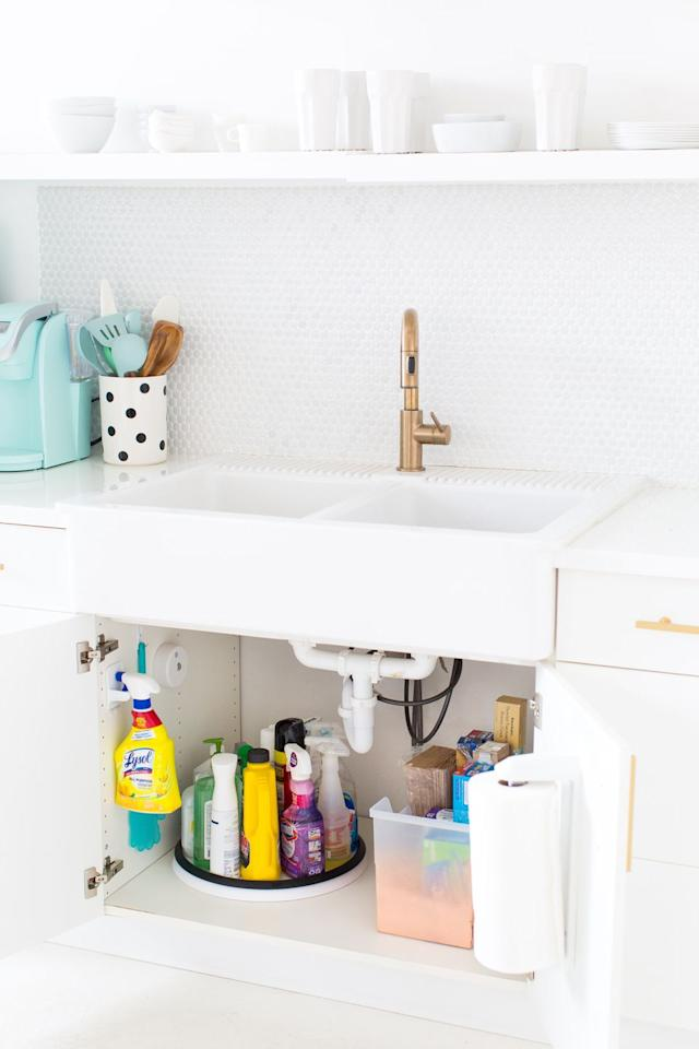 """<p>You're going to be less inclined to actually want to clean if you can't find any of your cleaning products. Use a lazy susan to hold spray bottles, then contain sponges, towels, and trash bags in plastic containers.</p><p>See more at <a href=""""https://sugarandcloth.com/our-studio-reno/"""" target=""""_blank"""">Sugar & Cloth</a>.</p>"""