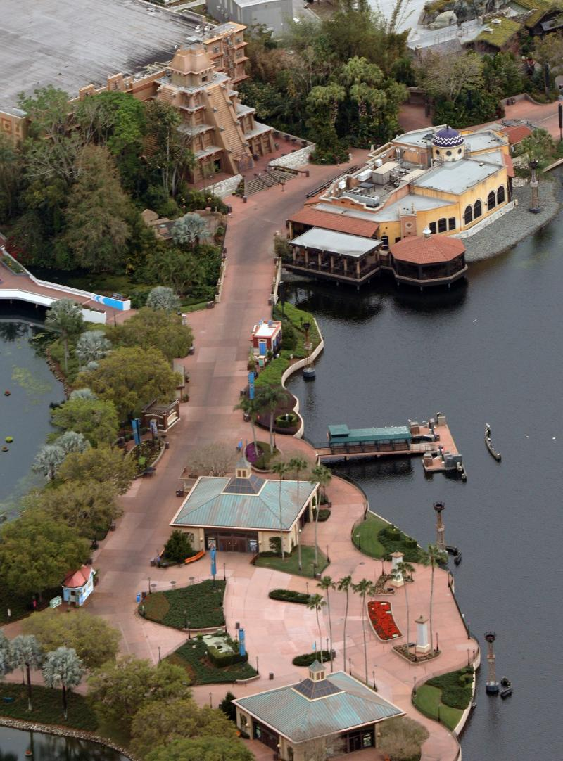 Empty streets are seen near a Mesoamerican pyramid (top left) and the Cantina de San Angel (right) at the Mexico Pavilion at Disney's Epcot theme park after it was closed to visitors in an effort to combat the spread of coronavirus disease (COVID-19), in an aerial view in Orlando, Florida, U.S. March 15, 2020. REUTERS/Gregg Newton