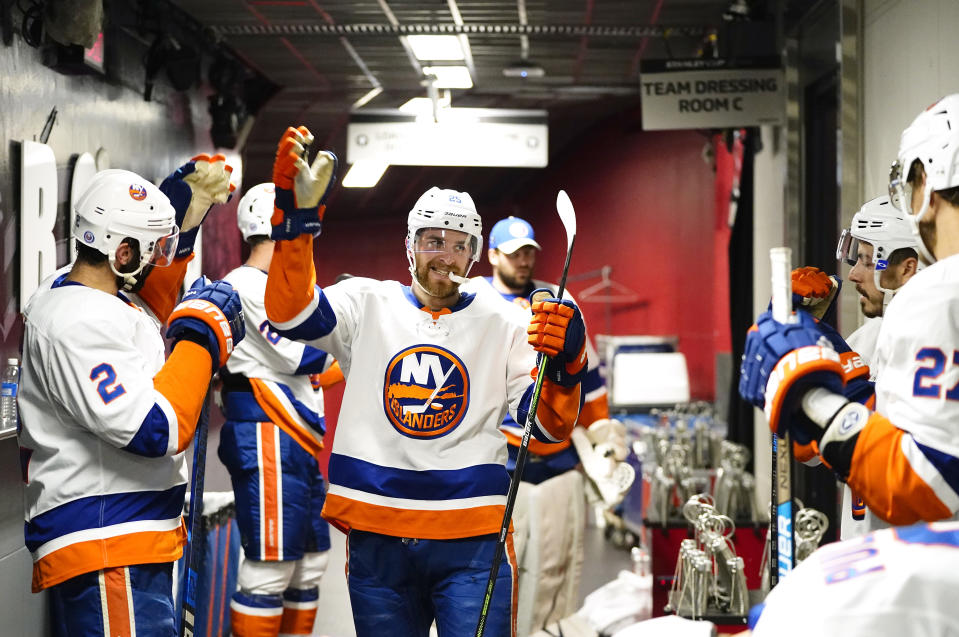 TORONTO, ONTARIO - SEPTEMBER 05: Devon Toews #25 of the New York Islanders greets teammates before taking the ice to play against the Philadelphia Flyers in the second period of Game Seven of the Eastern Conference Second Round of the 2020 NHL Stanley Cup Playoffs at Scotiabank Arena on September 05, 2020 in Toronto, Ontario. (Photo by Mark Blinch/NHLI via Getty Images)