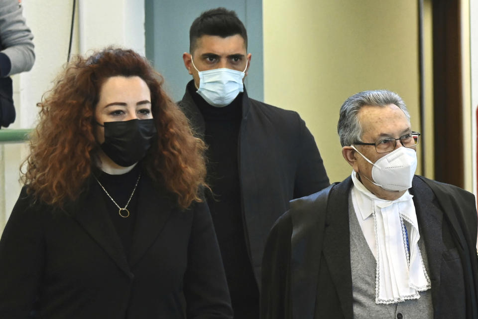 Rosa Maria Esilio, left, widow of slain Carabinieri military police officer Mario Cerciello Rega, followed by Paolo Cerciello Rega, brother of Mario, arrives with their lawyer Franco Coppi for a hearing in the trial where two American tourists are accused of slaying the plainclothes Carabinieri officer while on vacation in Italy in July 2019, in Rome, Monday, March 1, 2021. (Alberto Pizzoli/Pool Photo via AP)