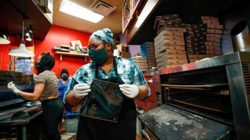 Marquisha Byrd makes acrylic face shields for front line responders at Dimo's Pizza in Chicago, Illinois, on April 16, 2020