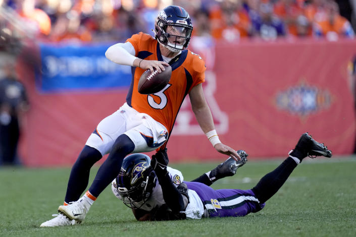 Denver Broncos quarterback Drew Lock (3) is tackled by Baltimore Ravens linebacker Odafe Oweh pursues during the second half of an NFL football game, Sunday, Oct. 3, 2021, in Denver. (AP Photo/David Zalubowski)