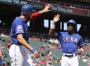 Texas Rangers' Hunter Pence (24) greets Delino DeShields (3) after they scored on a single by Jeff Mathis in the third inning of a baseball game against the Minnesota Twins, Sunday, Aug. 18, 2019, in Arlington, Texas. (AP Photo/Richard W. Rodriguez)