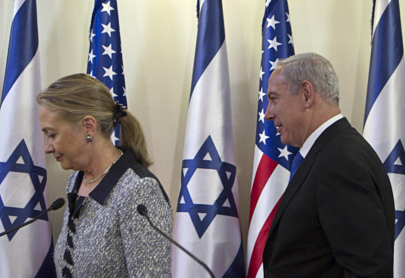 """Israel's Prime Minister Benjamin Netanyahu, right, and U.S. Secretary of State Hillary Rodham Clinton leave after delivering joint statements in Jerusalem, Tuesday, Nov. 20, 2012. A diplomatic push to end Israel's nearly weeklong offensive in the Gaza Strip gained momentum Tuesday, with Egypt's president predicting that airstrikes would soon end, the U.S. secretary of state racing to the region and Israel's prime minister saying his country would be a """"willing partner"""" to a cease-fire with the Islamic militant group Hamas.(AP Photo/Baz Ratner, Pool)"""