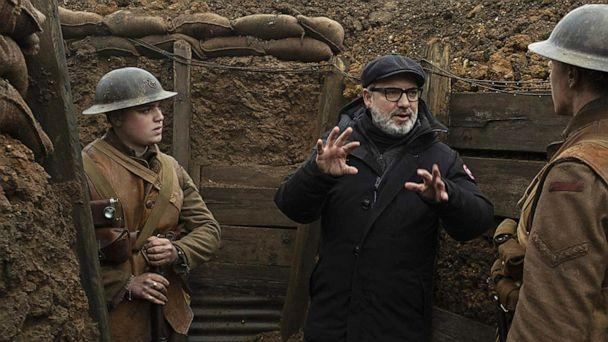 PHOTO: Director Sam Mendes speaks with actors George McKay and Dean-Charles Chapman on the set of the 2019 film, '1917.' (Universal Pictures)