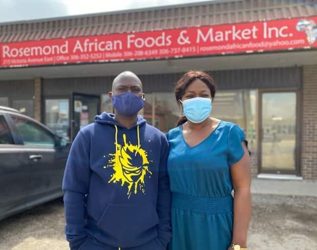 Babatunde and Oluwakemi Raji-Oyewole pose in front of their African grocery store in Regina.