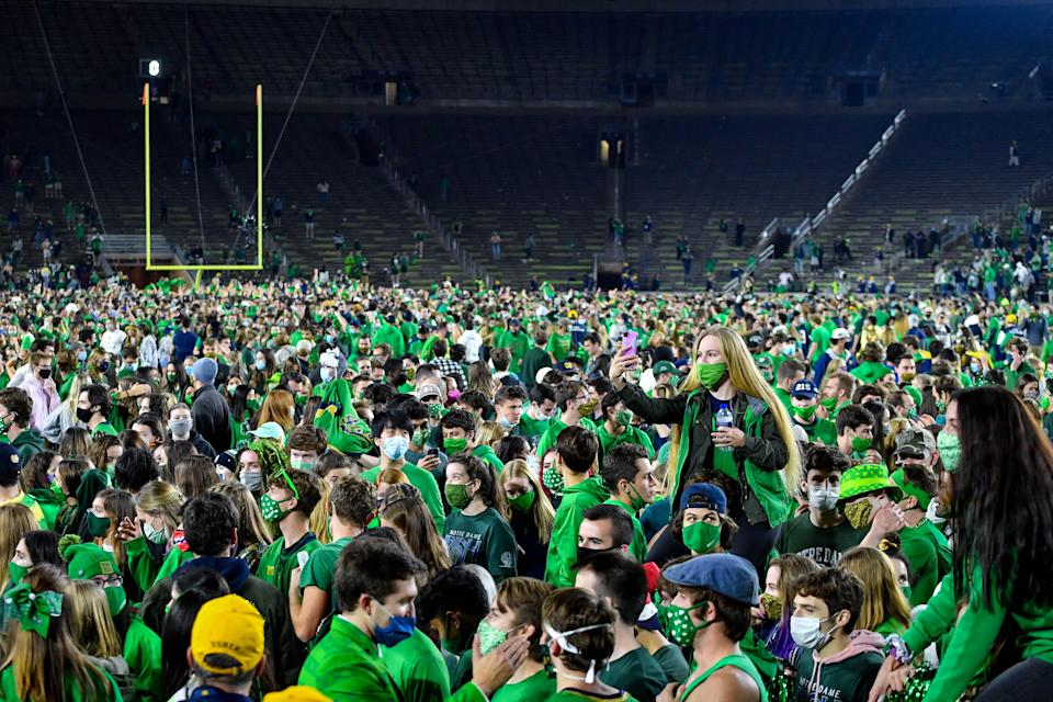 Fans storm the field after the Notre Dame Fighting Irish defeated the Clemson Tigers 47-40 in double overtime on Nov. 7, 2020 in South Bend, Indiana. (Matt Cashore-Pool/Getty Images)