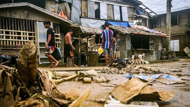 PHOTO: Residents clean out debris from floods caused by Typhoon Surigae in Arteche, Eastern Samar, eastern Philippines, April 20, 2021. (AP, FILE)