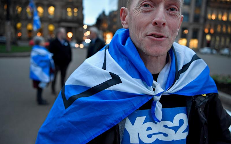 Independence supporters gathered Glasgow following the announcement  - Credit: Getty Images/Jeff J Mitchell