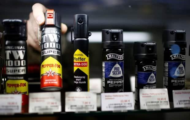 A file photo shows a row of pepper spray canisters in a gun shop in Germany. Alberta's request for the federal government to remove pepper spray from the list of prohibited weapons in the Criminal Code has been denied.  (Reuters - image credit)