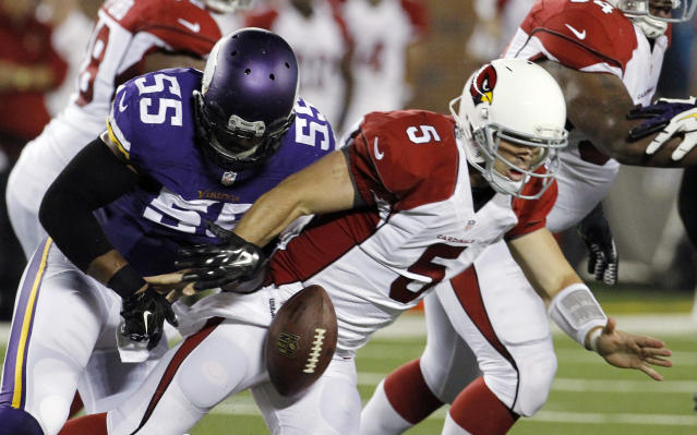 Minnesota Vikings outside linebacker Anthony Barr (55) forces a fumble by Arizona Cardinals quarterback Drew Stanton (5) during the first half of an NFL preseason football game, Saturday, Aug. 16, 2014, in Minneapolis. (AP Photo/Ann Heisenfelt)