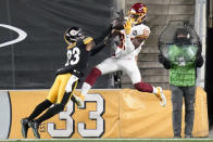 Pittsburgh Steelers cornerback Joe Haden (23) breaks up a pass intended for Washington Football Team wide receiver Cam Sims (89) during the second half of an NFL football game, Monday, Dec. 7, 2020, in Pittsburgh. (AP Photo/Keith Srakocic)