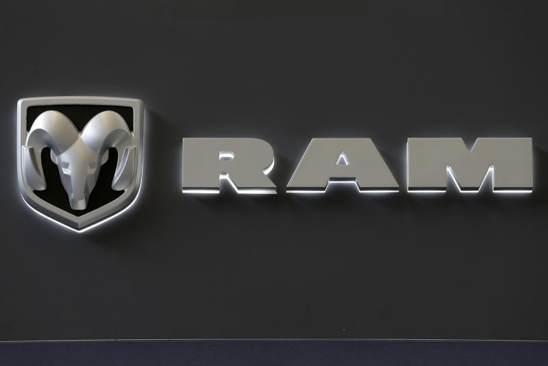 In this Feb. 14, 2013 photo, the Dodge Ram truck logo appears on a sign at the 2013 Pittsburgh Auto Show in Pittsburgh. Sales from the major automakers are expected to show that confident U.S. buyers snapped up new cars and trucks at a strong pace in June. Chrysler said Tuesday, July 2, 2013, that its sales rose 8 percent for its best June since 2007. Ram brand sales rose 23 percent and Dodge sales were up 12 percent on the strength of the Dodge Dart small car. (AP Photo/Gene J. Puskar)