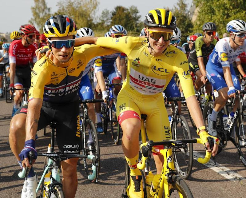 Primoz Roglic, left, who lost his overall leader's yellow jersey to Tadej Pogacar, right, hug during the twenty-first and last stage from Mantes-La-Jolie to Paris.