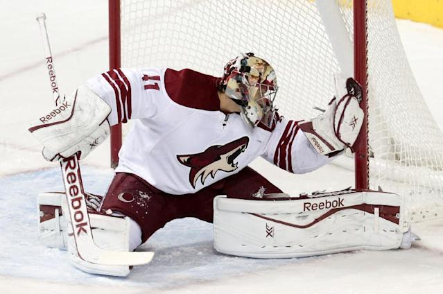 Phoenix Coyotes goalie Mike Smith makes a save against the Nashville Predators in the first period of an NHL hockey game Monday, Nov. 25, 2013, in Nashville, Tenn. (AP Photo/Mark Humphrey)