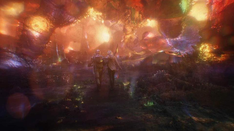 Two people walk through the surreal colorful world of the quantum realm in ant-man and the wasp