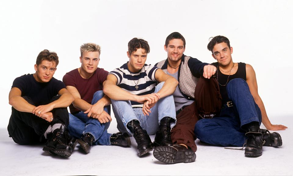 English boy band Take That, portrait, United Kingdom, 1992. Mark Owen, Gary Barlow, Jason Orange, Howard Donald, Robbie Williams. (Photo by Tim Roney/Getty Images)