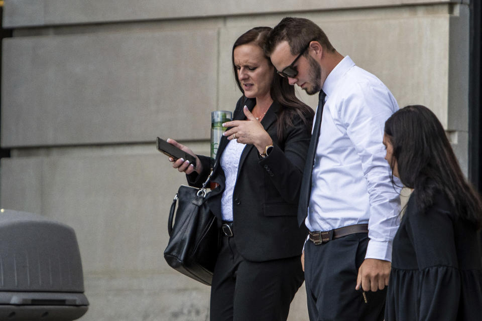 Trevor Gray, 18, right, and defense attorney Jessica Mainprize-Hajek exit the Genesee County Circuit Court, Tuesday, Aug. 3, 2021 in Flint, Mich., after Gray, MarkSekelsky, 19, and Mikadyn Payne, 19, were sentenced to probation for their part in a 2017 rock-throwing incident that killed a motorist on Interstate 75 after spending more than three years in custody while their case was stuck in court. (Isaac Ritchey/The Flint Journal via AP)