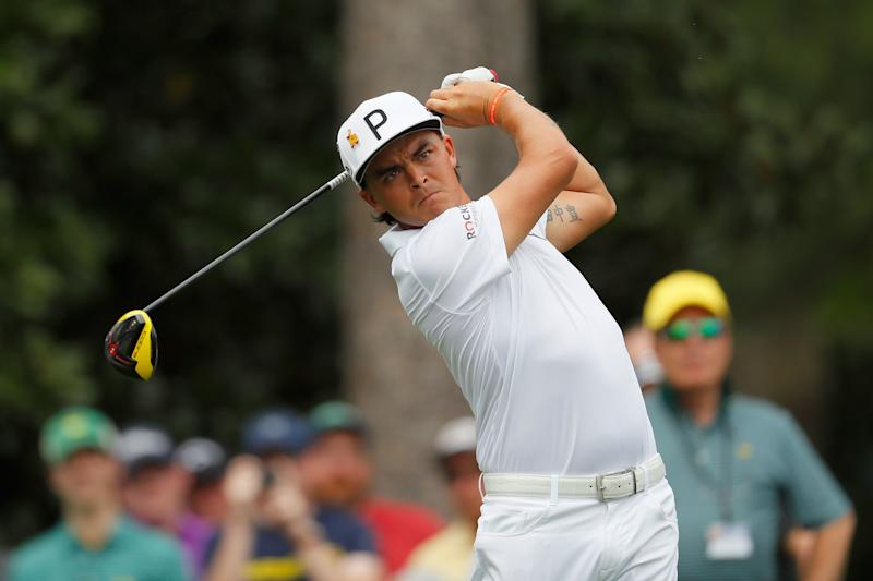 Rickie Fowler plays a shot during a Monday practice round prior to the 2019 Masters.