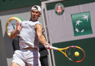 Spain's Rafael Nadal returns the ball during a training session at Roland Garros stadium ahead of the French Open tennis tournament in Paris, Thursday, May 27, 2021. (AP Photo/Michel Euler)