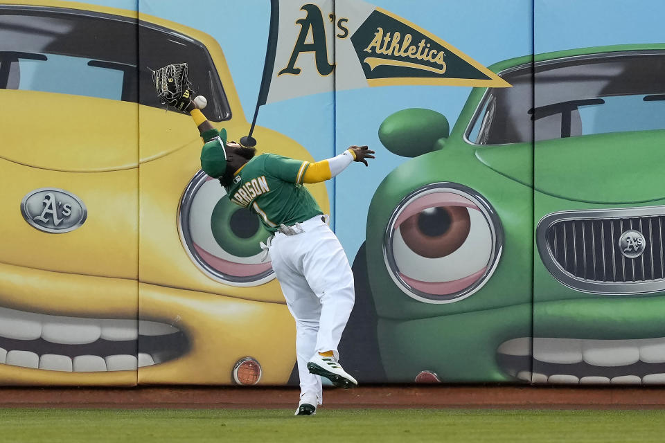Oakland Athletics left fielder Josh Harrison cannot make the catch on a double by New York Yankees' Anthony Rizzo during the third inning of a baseball game Thursday, Aug. 26, 2021, in Oakland, Calif. (AP Photo/Tony Avelar)
