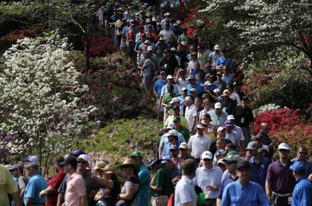 Golf patrons walk down the 6th hole during practice for the 2018 Masters golf tournament at Augusta National Golf Club in Augusta, Georgia, U.S. April 2, 2018. REUTERS/Jonathan Ernst