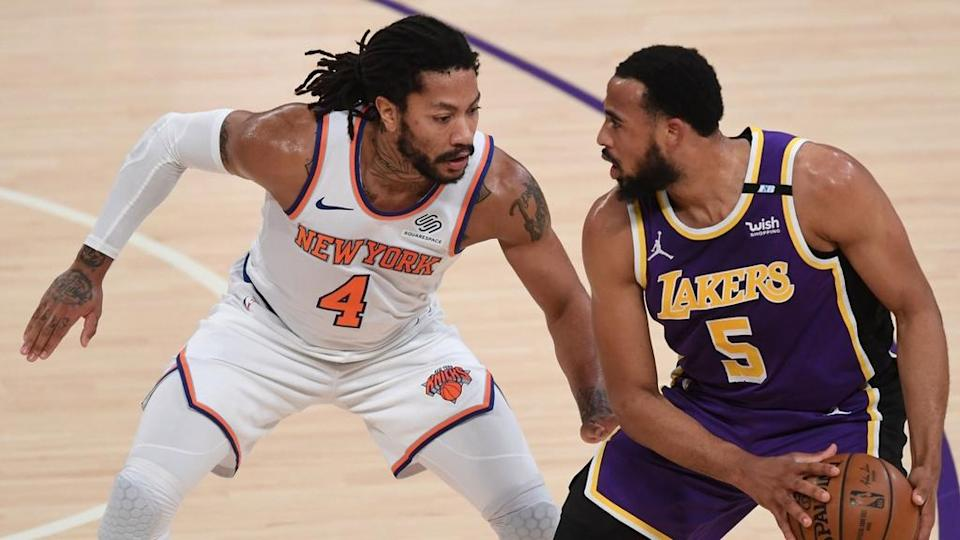 Derrick Rose defends against Lakers white jersey