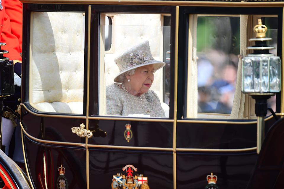 Queen Elizabeth II makes her way from Buckingham Palace to Horse Guards Parade, in London, ahead of the Trooping the Colour ceremony, as she celebrates her official birthday.