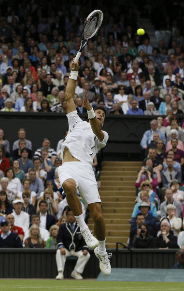 Novak Djokovic of Serbia smashes the ball to Bobby Reynolds of the United States during their Men's second round singles match at the All England Lawn Tennis Championships in Wimbledon, London, Thursday, June 27, 2013. (AP Photo/Kirsty Wigglesworth)