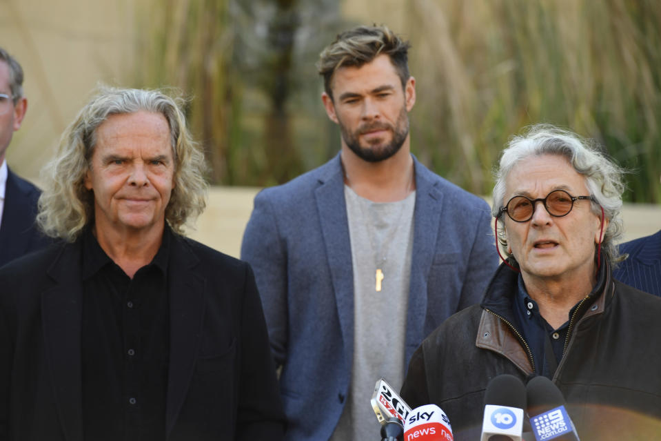 "From left, Producer Doug Mitchell, actor Chris Hemsworth and director George Miller attend at a press conference to announce the new ""Mad Max"" film at Fox Studios Australia in Sydney, Monday, April 19, 2021. (Mick Tsikas/AAP Image via AP)"