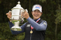 A Lim Kim, of South Korea, holds up the championship trophy after winning the U.S. Women's Open golf tournament, Monday, Dec. 14, 2020, in Houston. (AP Photo/Eric Gay)