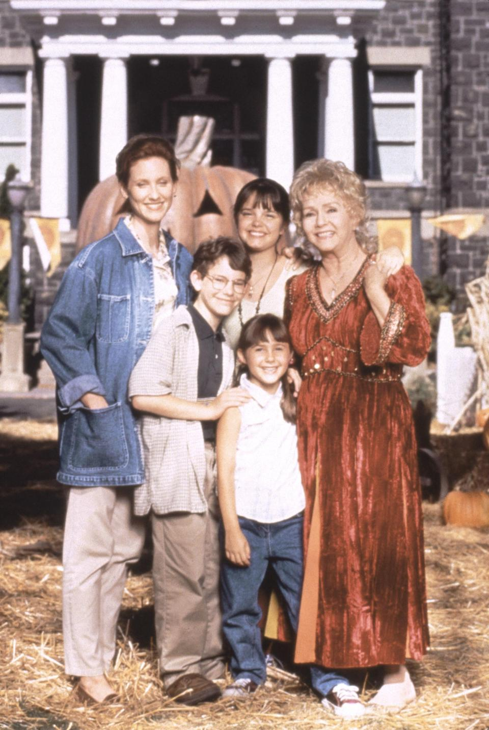 """<p>A modern classic, <em>Halloweentown</em> follows Marnie Piper on her journey of discovering she's a witch and having to decide whether she'll embrace her magical legacy or choose to live as a mortal. Aside from seeing what a utopia of witches, vampires, and monsters might look like, another major selling point of the film is getting to watch Debbie Reynolds as Aggie, Marni's grandmother, whisk about town in a slew of bedazzled gowns.</p> <p><a href=""""https://disneyplus.bn5x.net/VryLJ"""" rel=""""nofollow noopener"""" target=""""_blank"""" data-ylk=""""slk:Available on Disney+"""" class=""""link rapid-noclick-resp""""><em>Available on Disney+</em></a></p>"""