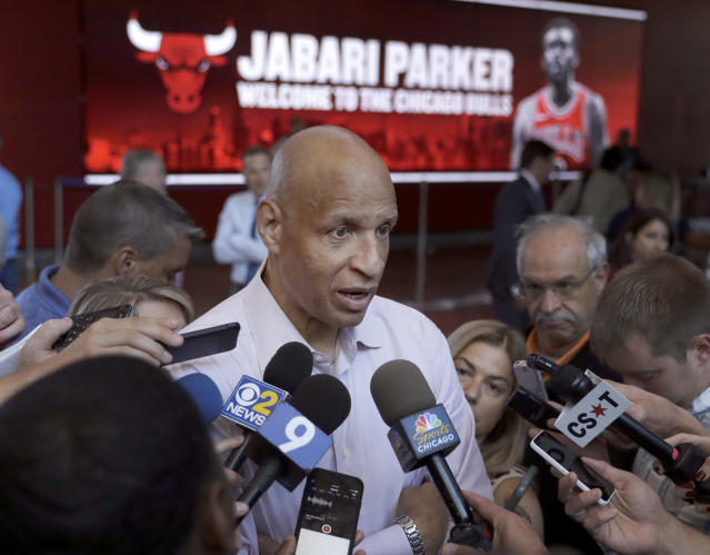 Jabari Parker's father Sonny, a retired NBA player with the Golden State Warriors, talks with reporters after a news conference where his son was introduced as the newest member of the Bulls Wednesday, July 18, 2018, in his hometown of Chicago. (AP Photo/Charles Rex Arbogast)
