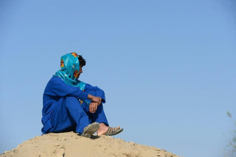 An Afghan boy, who was held as a child sex slave, sitting at a unidentified location in Afghanistan