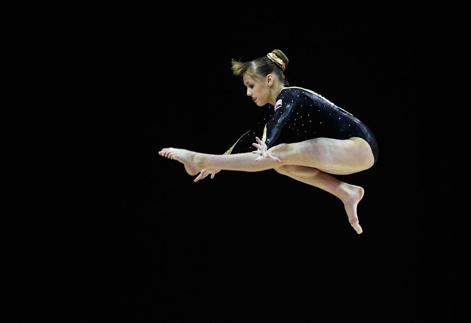 At 15 years old, Rebecca Tunney of Great Britain in action on the balance beam during the Women's Artistic Gymnastics Olympic Qualification round at North Greenwich Arena on January 11, 2012 in London, England. (Paul Gilham/Getty Images)